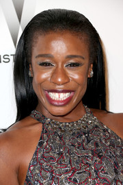 Uzo Aduba opted for a partless, slicked-back hairstyle when she attended the Weinstein Company and Netflix Golden Globes party.