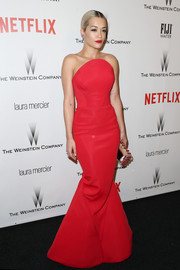 Rita Ora sported one of her most phenomenal looks for the Weinstein Company and Netflix Golden Globes party--a Zac Posen strapless gown that was dramatic both in color and in shape.