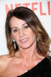 Nadia Comaneci opted for a simple wavy hairstyle when she attended the Weinstein Company and Netflix Golden Globes party.