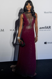 Naomi Campbell dazzled at the amfAR Hong Kong Gala in a beaded purple Marc Jacobs gown with a cleavage-baring panel.