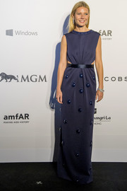 Gwyneth Paltrow was whimsically elegant at the amfAR Hong Kong Gala in an indigo Marc Jacobs cutout gown with a bauble-adorned skirt and neckline.