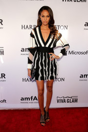 Joan Smalls was vibrant and modern on the amfAR Inspiration Gala red carpet in a Givenchy mini dress with a striped bodice and a ruffle skirt.