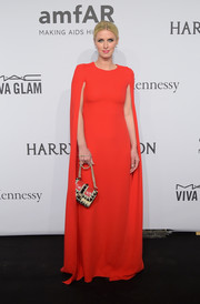 Nicky Hilton complemented her dramatic gown with an edgy-glam chain-strap bag.