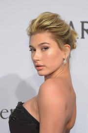 Hailey Baldwin brushed her hair back into a romantic loose updo for the amfAR New York Gala.