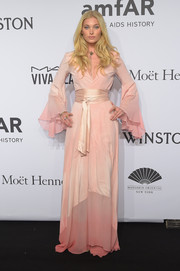 Elsa Hosk was boudoir-glam at the amfAR New York Gala in a pink Stone Fox Bride wrap gown with flutter sleeves and a satin sash.
