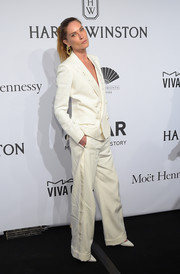 Erin Wasson went for a masculine vibe in a white Schiaparelli pantsuit during the amfAR New York Gala.