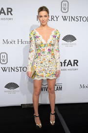 Melissa Bolona styled her dress with mirrored gold platform peep-toes.