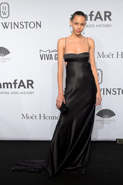 Binx Walton looked sizzling-hot at the amfAR New York Gala in a slinky black satin slip dress with waist cutouts.
