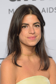 Leandra Medine attended the amfAR New York Gala wearing a simple center-parted 'do.