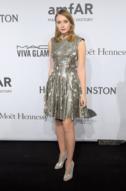Olga Sorokina stood out at the amfAR New York Gala in a silver IRFE star-print dress that was fun and playful yet very chic.