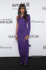Naomi Campbell opted for a purple Emilio Pucci gown in a bold one-shoulder-and-sleeve design for the amfAR New York Gala.