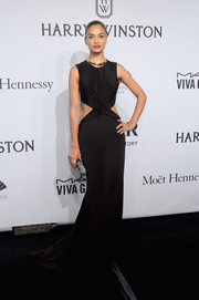 Shanina Shaik was trendy-glam at the amfAR New York Gala in a black gown with waist cutouts and crisscross detailing.