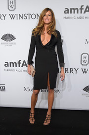 Kelly Bensimon sealed off her daring look with stylish black gladiator heels.