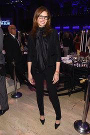 Desiree Gruber paired a black cropped jacket with a silk tie-neck blouse for her amfAR New York Gala look.