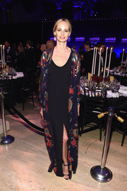 Lauren Santo Domingo layered a languid, paisley-patterned coat over a black column dress for her amfAR New York Gala look.