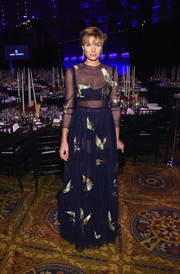 Jessica Hart flashed some skin in a sheer, bird-embroidered navy gown by Valentino at the amfAR New York Gala.