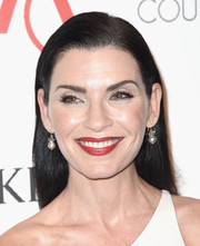 Julianna Margulies wore a sleek straight side-parted style at the 2016 ACE Awards.
