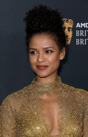 Gugu Mbatha-Raw looked glamorous with her tight curls swept into an updo during the 2016 BAFTA Britannia Awards.