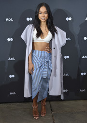 Karrueche Tran showcased her cleavage and abs in a white bra top during the 2016 AOL NewFront.