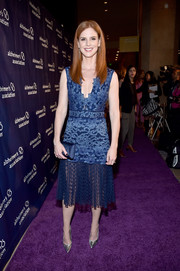 Sarah Rafferty chose a patterned, sheer-bottom cocktail dress by Tadashi Shoji for the Alzheimer Association's A Night at Sardi's event.