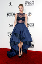 Rebecca Romijn looked pageant-ready in a blue Rita Vinieris gown, boasting a sheer lace bodice and a voluminous high-low skirt, at the 2016 AMAs.