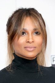 Ciara played down her kissers with nude lipstick.
