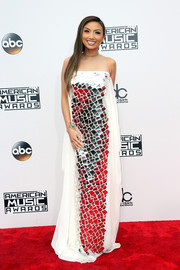 Jeannie Mai was modern-glam at the 2016 AMAs in a white gown with an illusion neckline and mirror detailing down the front.