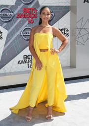 Mya teamed her top with cigarette pants in a matching yellow hue.