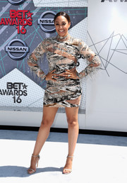 Tia Mowry polished off her look with silver Stuart Weitzman Nudist sandals.