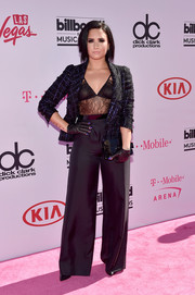 Demi Lovato pulled her outfit together with a pair of black wide-leg pants.