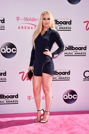 Lindsey Vonn showed plenty of leg in a navy mini dress with pearl-embellished sleeves at the Billboard Music Awards.