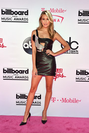 Renee Bargh went super flirty in a black Anthony Vaccarello one-shoulder cutout dress with silver ruffle detailing for the Billboard Music Awards.