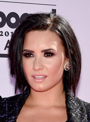 Demi Lovato injected some sparkle with a pair of Chanel rhinestone CC logo earrings.