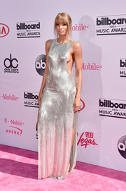 Ciara oozed major sex appeal at the Billboard Music Awards in a silver Philipp Plein chainmail gown that showcased her side cleavage and legs.