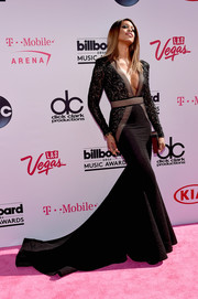 Laverne Cox struck a pose on the Billboard Music Awards pink carpet wearing a dramatic black fishtail gown with a plunging neckline and a lacy bodice.