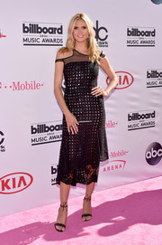 Heidi Klum looked playfully chic in a sheer, asymmetrical lattice and lace dress at the Billboard Music Awards.