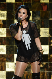 Demi Lovato looked racy in a sheer black shirt while performing at the 2016 Billboard Music Awards.