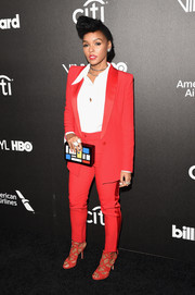 Janelle Monae was androgynous-chic in a red satin-trimmed pantsuit by Cristiano Burani at the Billboard Power 100 celebration.