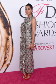 Tracee Ellis Ross continued the metallic motif with a silver clutch.