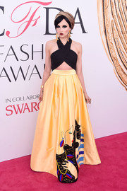 Stacey Bendet paired her cute top with a yellow maxi skirt with a portrait motif.
