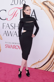 Coco Rocha was edgy and trendy at the 2016 CFDA Fashion Awards in a black turtleneck cutout dress from her own line.