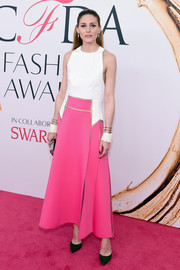 Olivia Palermo went for an unusual color pairing with these dark emerald pumps and pink and white dress.