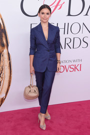 Miroslava Duma was all business in a blue pinstriped pantsuit at the 2016 CFDA Fashion Awards.