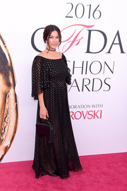 Rebecca Minkoff completed her look with a tasseled black leather purse.