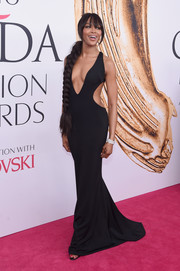 Naomi Campbell's cleavage and waist stole the spotlight when she wore this black Brandon Maxwell cutout gown to the 2016 CFDA Fashion Awards. Does this woman ever age?!