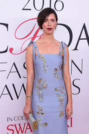 Rebecca Hall accessorized with a silver and gold Edie Parker clutch for some glitter to her look during the 2016 CFDA Fashion Awards.