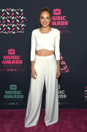 Danielle Bradbery flaunted her flat abs in a white crop-top during the 2016 CMT Music Awards.