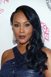 Vivica A. Fox wore her hair down in glamorous side-swept curls during the 2016 Carousel of Hope Ball.