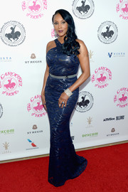 Vivica A. Fox sheathed her curves in a metallic blue halter gown by St. John for the 2016 Carousel of Hope Ball.