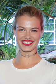 Hailey Clauson opted for a casual ponytail when she attended the Coach and Friends of the High Line Summer Party.